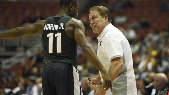 Michigan State head coach Tom Izzo expresses his point of view with guard Tum Tum Nairn during the first half of MSU's win over Providence Sunday in the final of the Wooden Legacy tournament in Anaheim, Calif.