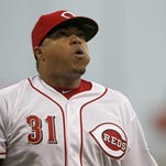 Cincinnati Reds starting pitcher Alfredo Simon (31) walks off the mound after a one-run top of the first inning of the MLB game between the Cincinnati Reds and the Pittsburgh Pirates at Great American Ball Park on Friday, April 8, 2016. After three innings the Reds led 3-1.
