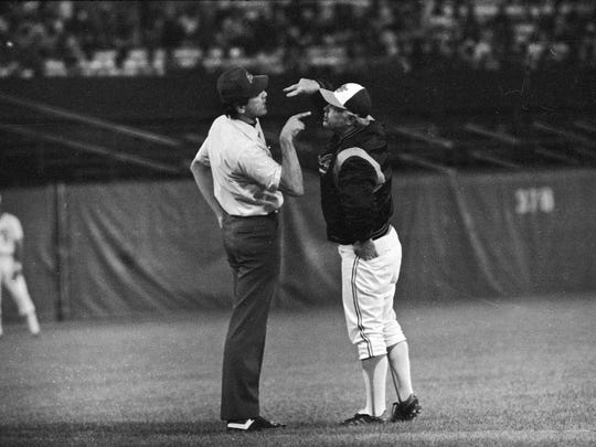 Umpire Steve Palermo mixing it up with Orioles manager Earl Weaver.
