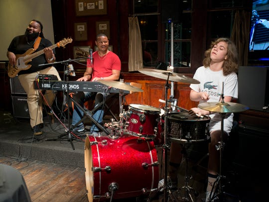 Fourteen-year-old JD Beck, of Dallas, Texas, sits in on drums as Chris Snowden, bass, and Gino Rosario, keyboard, perform during Tuesday Jazz at Seville Quarter in Pensacola on Tuesday, Oct. 10, 2017.