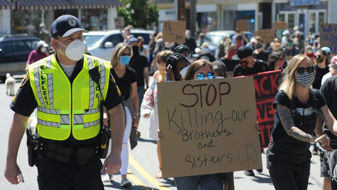 Wellfleet police officers mingled with protesters and accompanied them on a march for racial justice Sunday from Town Hall to the police station. Police chiefs across the Cape have spoken out against the death of George Floyd while in Minneapolis police custody.