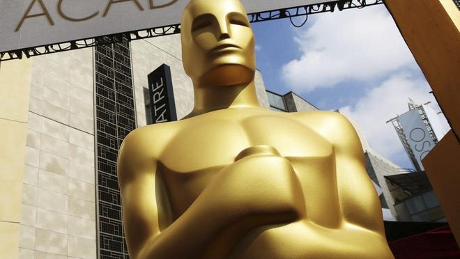The Oscar statue appears outside the Dolby Theatre for the 87th Academy Awards in Los Angeles. The Academy of Motion Picture Arts and Sciences pushed back the date of the 93rd Academy Awards from Feb. 28 to April 25 of next year