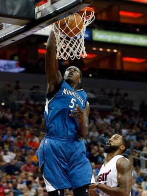 Minnesota's Gorgui Dieng with the slam dunk against Miami's Keith Benson.