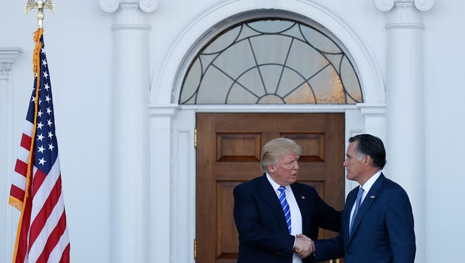 President-elect Donald Trump and Mitt Romney shake hands as Romney leaves Trump National Golf Club Bedminster in Bedminster, N.J., Saturday, Nov. 19, 2016.