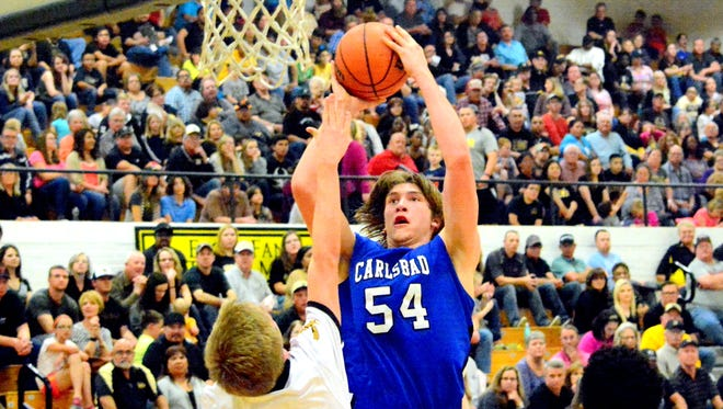 Carlsbad's Brenden Boatwright puts up a shot on Friday, Feb. 19 at Hobbs. The 6-foot-9 center signed his letter of intent Wednesday to play at NCAA Division II's Fort Lewis College in Durango, Colo.