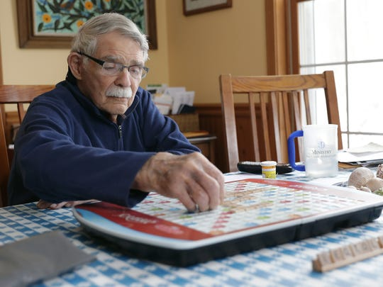 Jack Zito, 96, plays Scrabble at his kitchen table with Lisa Jeansonne, an end-of-life doula and caregiver, on Jan. 24, 2018 in Sister Bay, Wis. Sarah Kloepping/USA TODAY NETWORK-Wisconsin