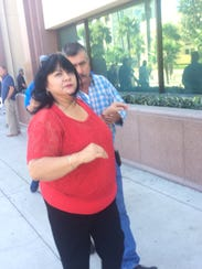Everardo Amador Sr. right, leaves court in Riverside,