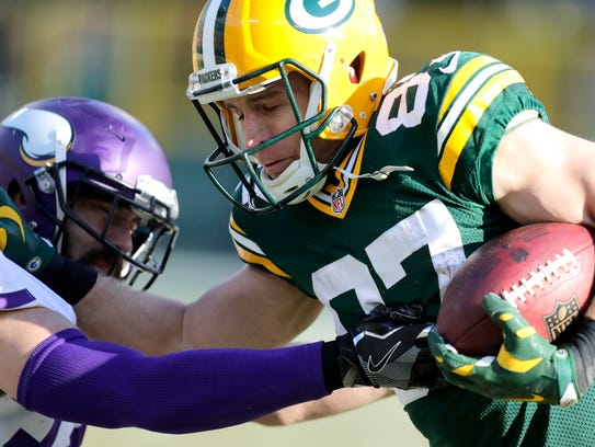 Jordy Nelson fights of Minnesota'a Andrew Sendejo.