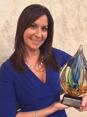 Nadia Mekled is Business Person of the Year in Canton.