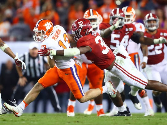 Clemson wide receiver Hunter Renfrow is tackled by Alabama linebacker Rashaan Evans during the College Football Playoff championship game.