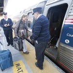 Passengers board an Amtrak train bound for Albany and points west, at the Metro-North Yonkers Train Station on April 16, 2014.
