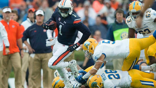 Auburn wide receiver D'haquille Williams (1) runs downfield as San Jose State linebacker Frank Ginda (5) attempts to stop him during the NCAA football game between Auburn and San Jose State on Saturday, Oct. 3, 2015, at Jordan-Hare Stadium in Auburn, Ala. Albert Cesare / Advertiser