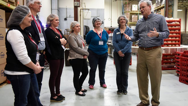 """Plant manager Bob Leuth describes operations during a """"How It's Made"""" tour by the St. Cloud Area Chamber of Commerce Friday, April 21, at Coborn's central baking facility in St. Cloud."""