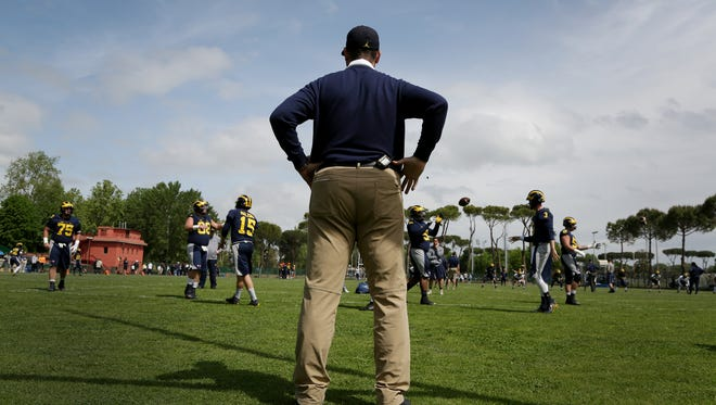 Michigan football coach Jim Harbaugh watches his players during their first practice in Rome at Giulio Onesti Training Center on Thursday, April 27, 2017.