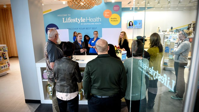 YMCA employees take a tour Tuesday, Sept. 26, of the newly opened Lifestyle Health facility in the St. Cloud Area Family YMCA Community and Aquatics Center.