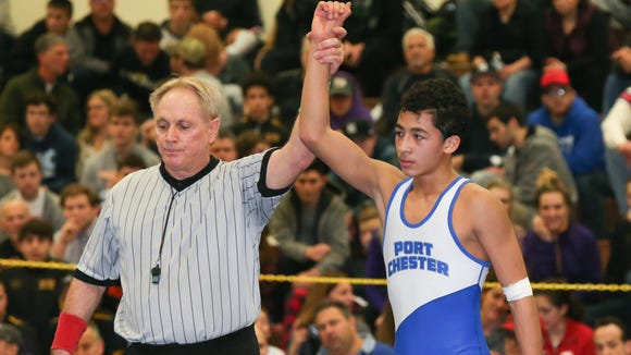Port Chester's Ivan Garcia, top, defeats Arlington's Dennis Robin in the  106-pound match at the Section 1, Division 1 wrestling finals at Clarkstown High School South in West Nyack on Sunday, February 11, 2018.