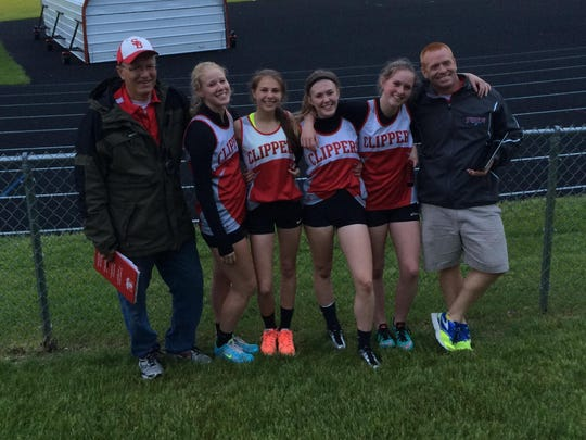 Sturgeon Bay's Allison Alberts, second from left, poses with her relay team during the 2015 track and field season.