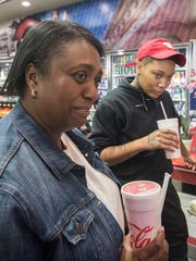 First-time customers Trish Adams and Cartier Morris wait for their order.
