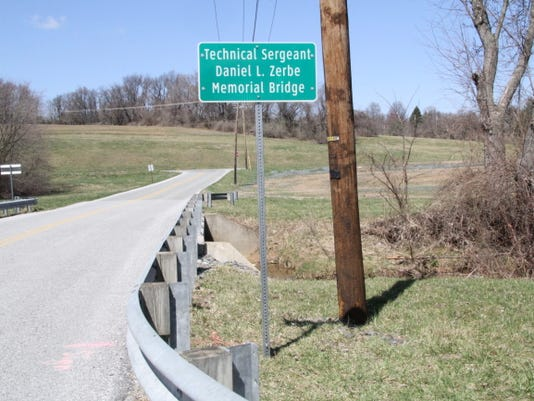A new sign notes the Technical Sergeant Daniel L. Zerbe Memorial Bridge, which was dedicated Saturday.
