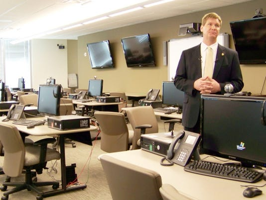 File- This March 9, 2012, file photo shows FBI spokesman Kyle Loven giving a tour of the Emergency Operations Center at the new Minneapolis-area field office in Brooklyn Center, Minn. Loven, spokesman for the Minneapolis office of the FBI, said six people were arrested Sunday, April 19, 2015, but gave no further details. An FBI spokesman in San Diego referred questions to Loven. (AP Photo/, File)