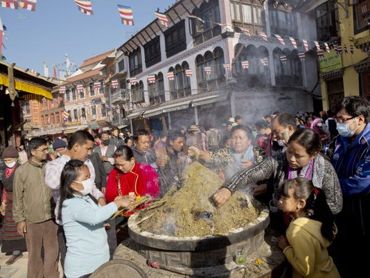 Nepalese Buddhists light incense sticks at the Boudhanath Stupa during Buddha Jayanti, or Buddha Purnima, festival in Kathmandu, Nepal, Monday, May 4, 2015. Hundreds of people have visited Buddhists shrines and monasteries in Nepalís quake-wracked Kathmandu on the birthday of Gautama Buddha to pray for the country and the people who suffered during April 25 earthquake. (AP Photo/)