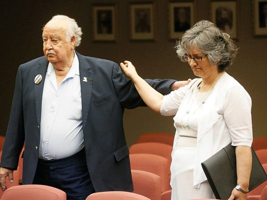 Manuel F. Aguilera shared a moment with Public Works Director Pat Adauto during an El Paso Commissioners Court public hearing Monday on the proposed renaming of a highway named after him. Several friends and family members spoke on Aguiler's behalf. The name is now the Aguilera International Highway.