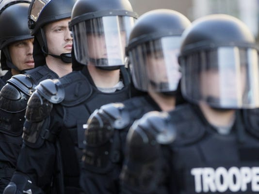 Riot police stand in formation on May 23, 2015 as a protest forms against the acquittal of Michael Brelo, a patrolman charged in the shooting deaths of two unarmed suspects in Cleveland.