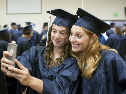 Kiersten Henry and Maggie Hoff, both graduating with a Bachelor of Science in Business, take a selfie before commencement. Penn State York celebrated its 45th annual spring commencement Friday at the Pullo Family Performing Arts Center.