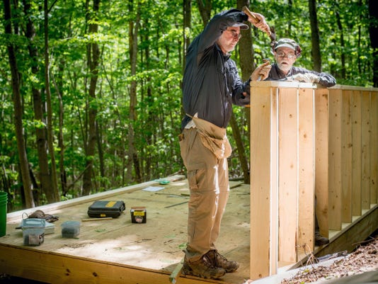 Frank Kempf and Ron Gray, volunteers with the Mason Dixon Trail System, construct the back wall of an overnight backpacker's shelter in Apollo County Park near New Bridgeville. Volunteers have been working on Thursdays for the last month on the structure, modeled after a shelter built on the Appalachian Trail.