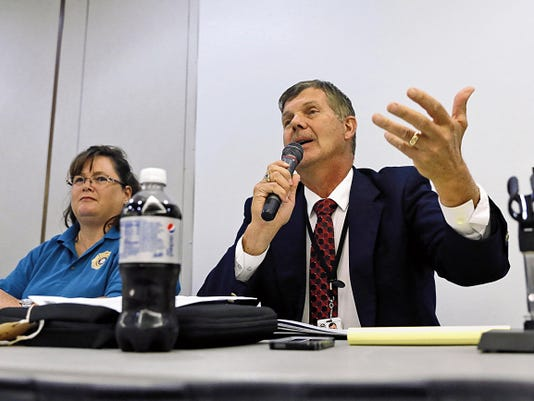 Farmington Municipal Schools Superintendent Eugene Schmidt speaks Wednesday during the Four Corners School Safety Summit at San Juan College's Henderson Fine Arts Center in Farmington as San Juan County Communications Authority Operations Manager Tandra Malcom listens.