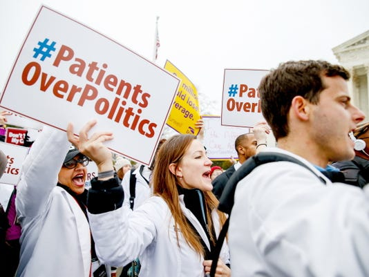 FILE - In this March 4, 2015 file photo, demonstrators chant during  health care rally outside the Supreme Court in Washington. The Supreme Court could wipe away health insurance for millions of Americans when it resolves the latest high court fight over President Barack Obama's health overhaul. But would the court take away a benefit from so many people, and should the justices even consider the consequences?  (AP Photo/Andrew Harnik, File)