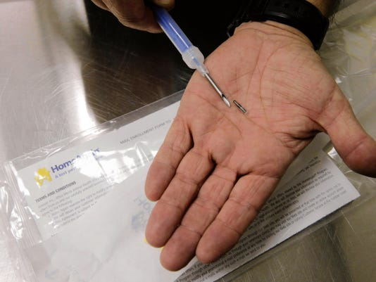 RUBEN R RAMIREZ—EL PASO TIMES One of the micro chips that are implanted into animals that are at the EL Paso Animal Services building before they are put out for adoption or recovery.