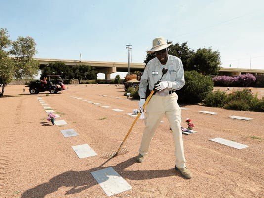 Curtis Jackson 56, one of three employees at the Fort Bliss National Cemetery who were homeless veterans, goes about his duties.