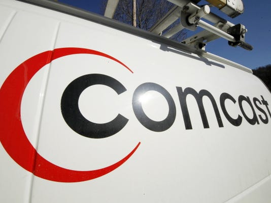 FILE - This Feb. 11, 2011 file photo shows the Comcast logo on one of the company's vehicles, in Pittsburgh. Wall Street appears increasingly convinced Comcast's 45.2 billion purchase of Time Warner Cable is dead.  telling indicator is the gap between the value Comcast's all-stock bid assigned to each Time Warner Cable share and Time Warner Cable stock's current price. That was at its widest point yet Thursday, April 23, 2015, a signal that investors are giving just 20 to 30 percent odds that the deal will go through, said Nomura analyst Adam Ilkowitz.