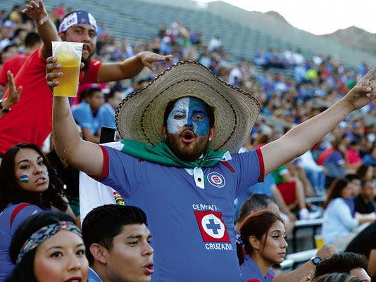RUBEN R. RAMIREZ—EL PASO TIMES Cruz Azul fans came out to supportt heir team at the Sun Bowl during action of their game against Club Tijuana Xoloitzcuinties de Caliente, Cruz Azul won the match 2-1.