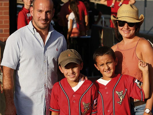 Severo Barreras (middle, left) become the one millionth fan to enter Southwest University Park. He was accompanied by father Jason (left), Hughston (middle, right), and Joanna (right).