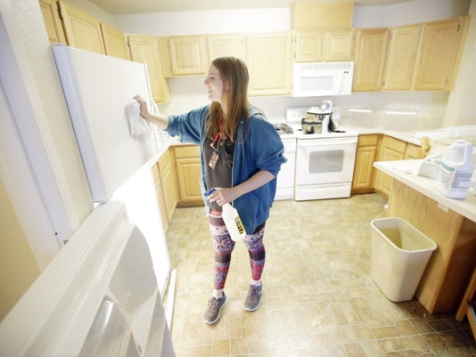 Student Emilee Gull cleans a dorm room in Eccles Living Learning Center on Aug. 7 at Southern Utah University, in Cedar City, Utah.