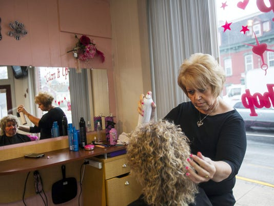 Sandi Claypool, owner of Glam It Up, styles the hair of Abbottstown resident and first time client Dorothy Creager on April 8 at the East Berlin salon at 104 West King St. Claypool opened the shop in November with her two daughters, Charlene Lockard and Missy Heath.