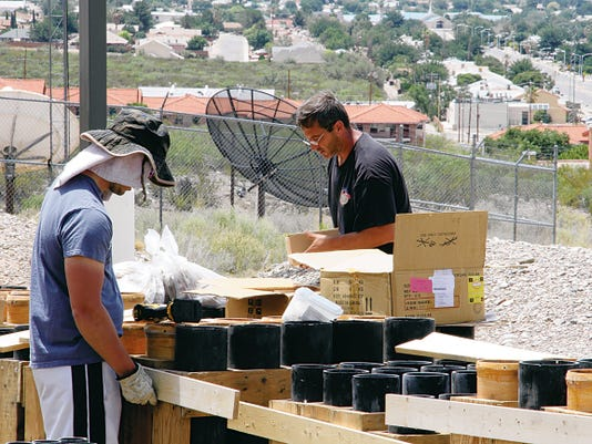 Pyro Shows Of Texas workers were setting up mortar tube racks Friday to blast off 2,090 fireworks into the Alamogordo skyline as part of the city's Fireworks Extravaganza. The fireworks show begins at 9:15 p.m. today with weather permitting.