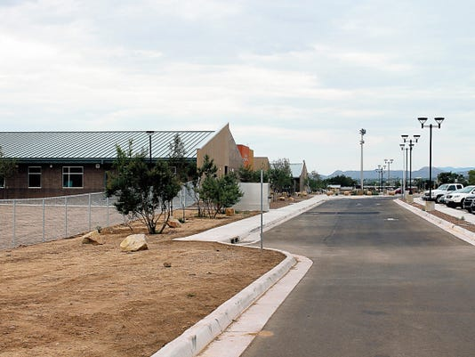 Christine Martin, parent of a Desert Star student, is concerned with the left side of the school which has a drop off from the sidewalk into a dirt lot which extends to the curb.