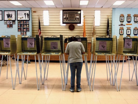 Carolyn Yazzie fills in her ballot Tuesday at the Shiprock Chapter house in Shiprock.