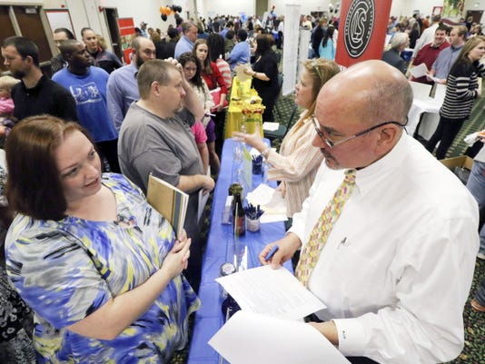 Frances Scoggins, left, speaks to Michael McCall, general manager for Chattanooga Labeling Systems, about her resume on Thursday during a huge 15-county North Georgia job fair at The Colonnade in Ringgold, Ga. Scoggins has been unemployed for the past 4-months and is looking for a safety or manufacturing job.