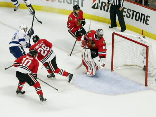 Tampa Bay Lightning center Cedric Paquette (13) slings the game-winning goal past Chicago Blackhawks goalie Corey Crawford (50) during the third period of Game 3 of the Stanley Cup Final on Monday at the United Center in Chicago.