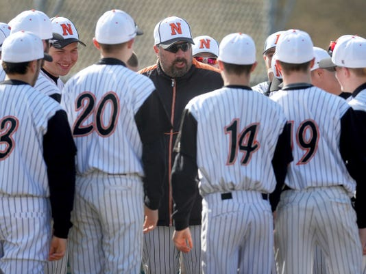 Northeastern coach Andy Srebroski talks to his team during a YAIAA baseball game against Spring Grove on March 24. Northeastern won, 14-1.