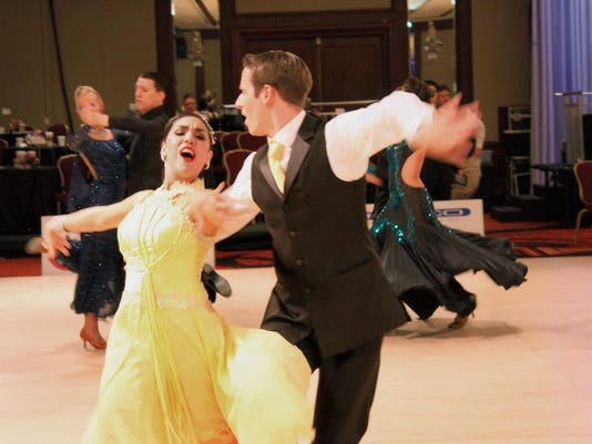 NMSU dancers tripping the light fantastic. The New Mexico State University DanceSport Company competed  season finale during the 2015 USA Dance National DanceSport Championships for their best showing at nationals of all-time.