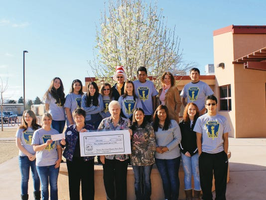 The Tularosa High School National Honor Society donated a check of 370.00 to the Dolly Parton's Imagination Library of Otero County. The students held bake sales to raise funds to donate to the early literacy program that supplies books to preschool children of Otero County.