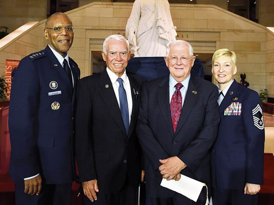 Air Force Vice Chief of Staff Gen. Larry O. Spencer, retired Air Force Col. Michael Brazelton, retired Air Force Col. William Driggers Jr., and the executive assistant to the chief master sergeant of the Air Force, Chief Master Sgt. Nicole Johnson, pose for photo in the Emancipation Hall of the U.S. Capitol Building in Washington, July 8 after the Congressional Commemoration of the 50th Anniversary of the Vietnam War.