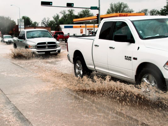 SARAH MATOTT - CURRENT-ARGUS   Streets across Carslbad flooded on Monday after a day of rain. Coincidentally, the Carlsbad city council approved a Phase I Draiage Master Plan to address the city's watershed and drainage issues.