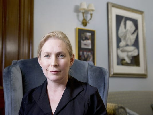 Sen. Kirsten Gillibrand, D-N.Y., poses for a portrait after speaking about military sexual assaults, during an interview in her office on Capitol Hill in Washington, Thursday, April 30, 2015.   The spouses of service members and civilian women who live or work near military facilities are especially vulnerable to being sexually assaulted, Sen. Kirsten Gillibrand, D-N.Y. said in a report.  (AP Photo/Jacquelyn Martin)