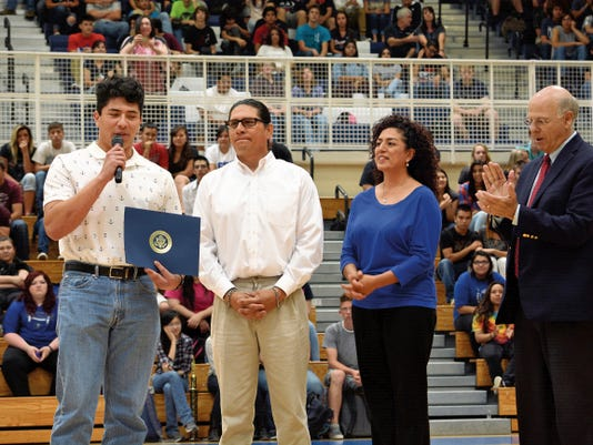 Matt Hollinshead — Current-Argus Accompanied by his parents, Max and Amy, and congressman Steve Pearce, Carlsbad senior Zy Marquez speaks to the student body at Wednesday's ceremony. Marquez, 18, will attend the Naval Academy.